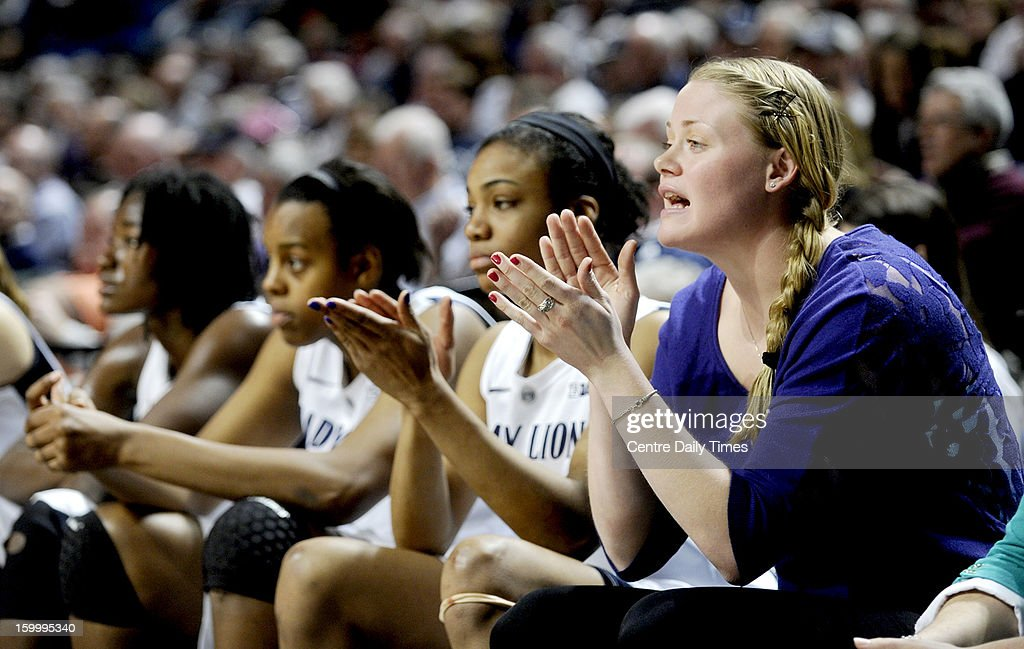 Penn State's Marisa Wolfe, right, cheers on her teammates during a 64-59 win over Minnesota on Thursday, January 24, 2013, at the Bryce Jordan Center in University Park, Pennsylvania.