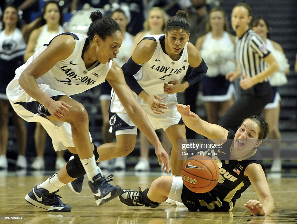Penn State's Mia Nickson, left, Dara Taylor and Purdue's Courtney Moses reach for a loose ball during a women's college basketball game in State College, Pennsylvania, Monday, February 4, 2013.