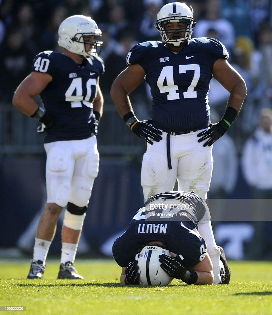 Penn State's Michael Mauti is injured as teammates Glenn Carson (40) and Jordan Hill (47) look on against Indiana at Beaver Stadium on Saturday, November 17, 2012, in State College, Pennsylvania. Penn State turned Indiana away, 45-22.