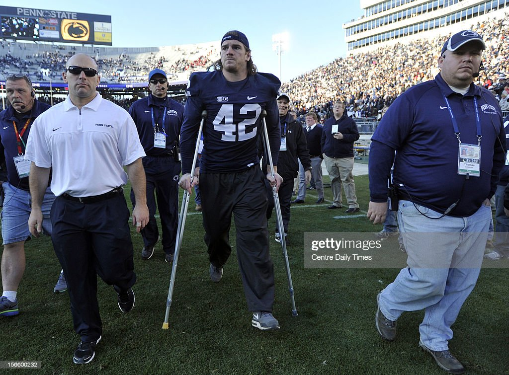 Penn State's Michael Mauti leaves the field on crutches after an injury against Indiana at Beaver Stadium on Saturday, November 17, 2012, in State College, Pennsylvania.