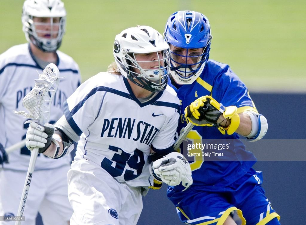 Penn State's Mike Sutton (39) cuts around Delaware's Jared Horoski during the game in State College, Pa., Saturday, April 19, 2014.