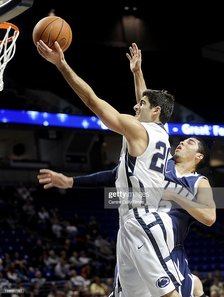 Penn State's Nick Colella goes up for a basket past New Hampshire's Chris Orozco during a men's college basketball game at the Bryce Jordan Center on Sunday, December 23, 2012, in State College, Pennsylvania.