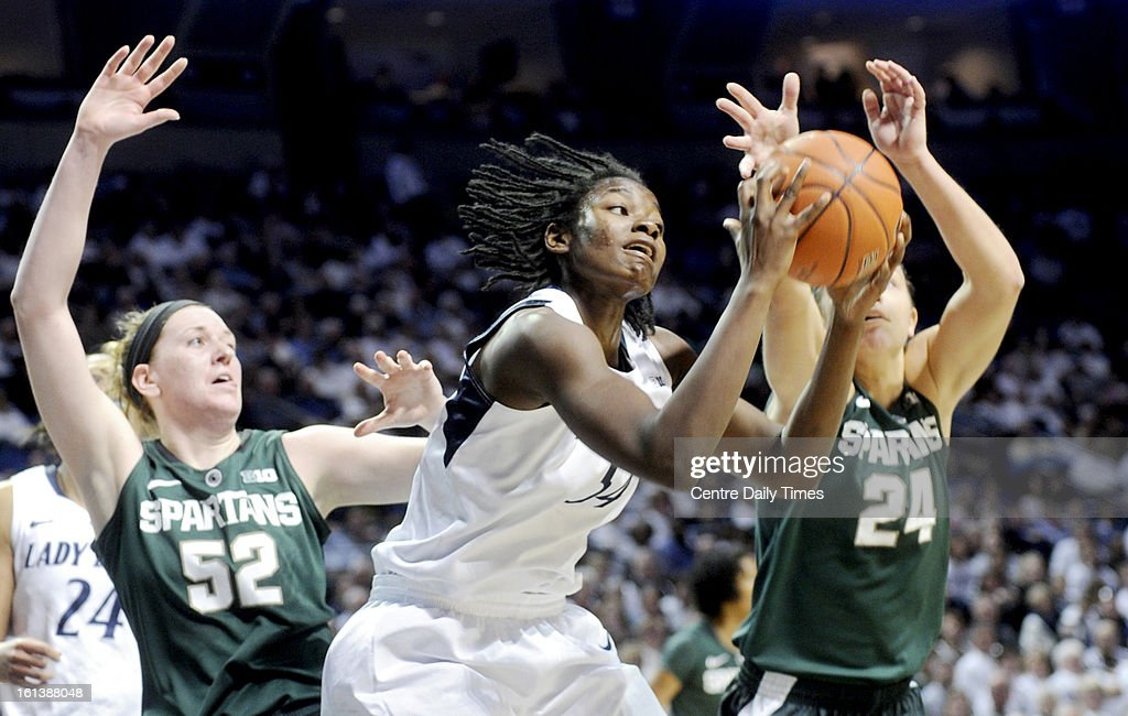 Penn State's Nikki Greene gets a rebound over Michigan State's Becca Mills and Cara Miller at the Bryce Jordan Center in State College, Pennsylvania, February 10, 2013. The Lady Lions won, 71-56.
