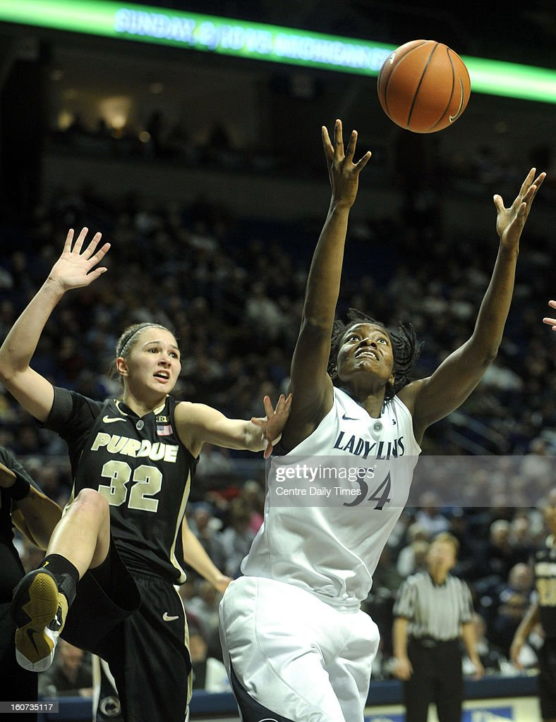 Penn State's Nikki Greene reaches for a rebound against Purdue's Sam Ostarello during a women's college basketball game in State College, Pennsylvania, Monday, February 4, 2013.