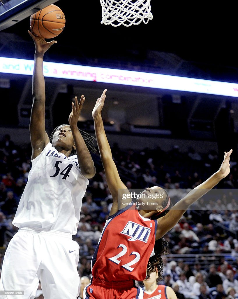 Penn State's Nikki Greene takes a shot over NJIT's Nyasia Davis during a women's college basketball game at the Bryce Jordan Center on Sunday, December 23, 2012, in State College, Pennsylvania.