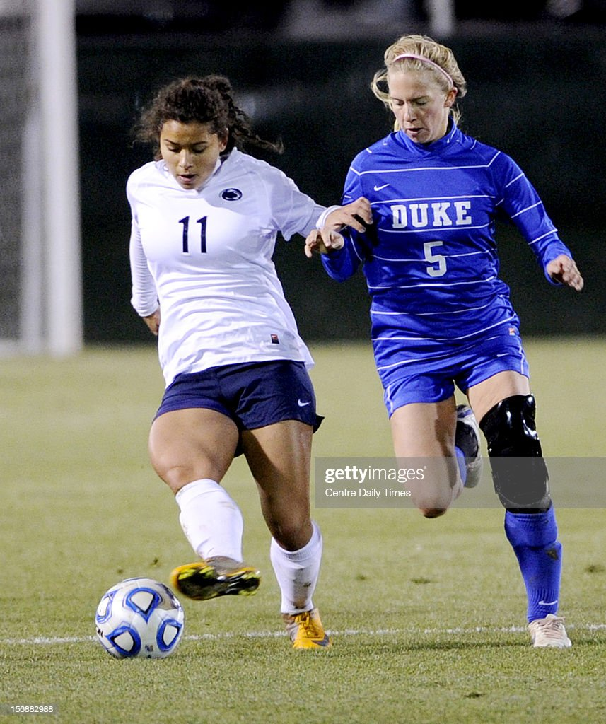 Penn State's Raquel Rodriguez Cedeno (11) fends off Duke's Kaitlyn Kerr in the quarterfinals of the NCAA championships on Friday, November 23, 2012, at Jeffrey Field in University Park, Pennsylvania. Penn State advanced, 1-0.