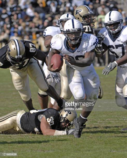 Penn State's RB Tony Hunt breaks through the line and breaks tackles in the 2nd half in Penn State's 120 win over Purdue at RossAde Stadium in West...