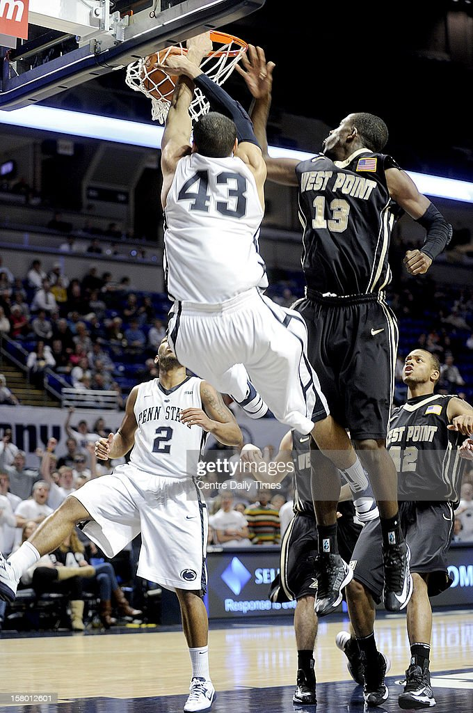 Penn State's Ross Travis (43) dunks the ball after a pass from D.J. Newbill (2) against Army on Saturday, December 8, 2012, at the Bryce Jordan Center in University Park, Pennsylvania. Penn State topped Army, 78-70.