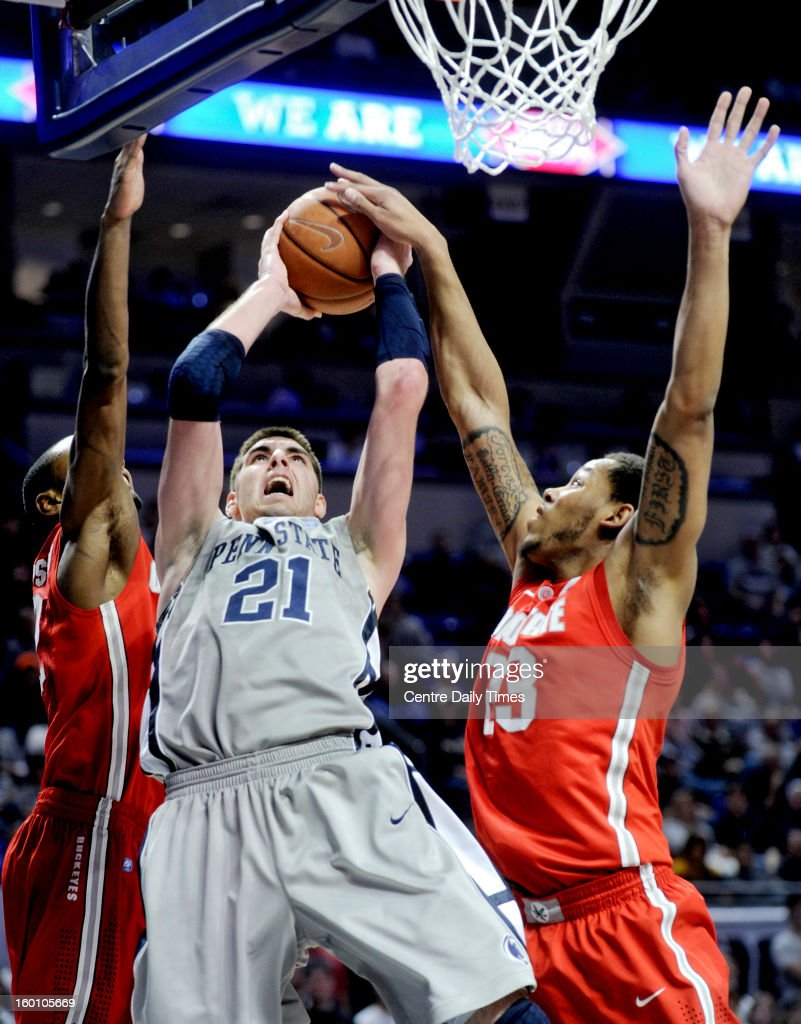Penn State's Sasa Borovnjak (21) goes up for a basket between Ohio State's Sam Thompson and Amir Williams (23) on Saturday, January 26, 2013, at the Bryce Jordan Center in University Park, Pennsylvania. Ohio State won, 65-51.