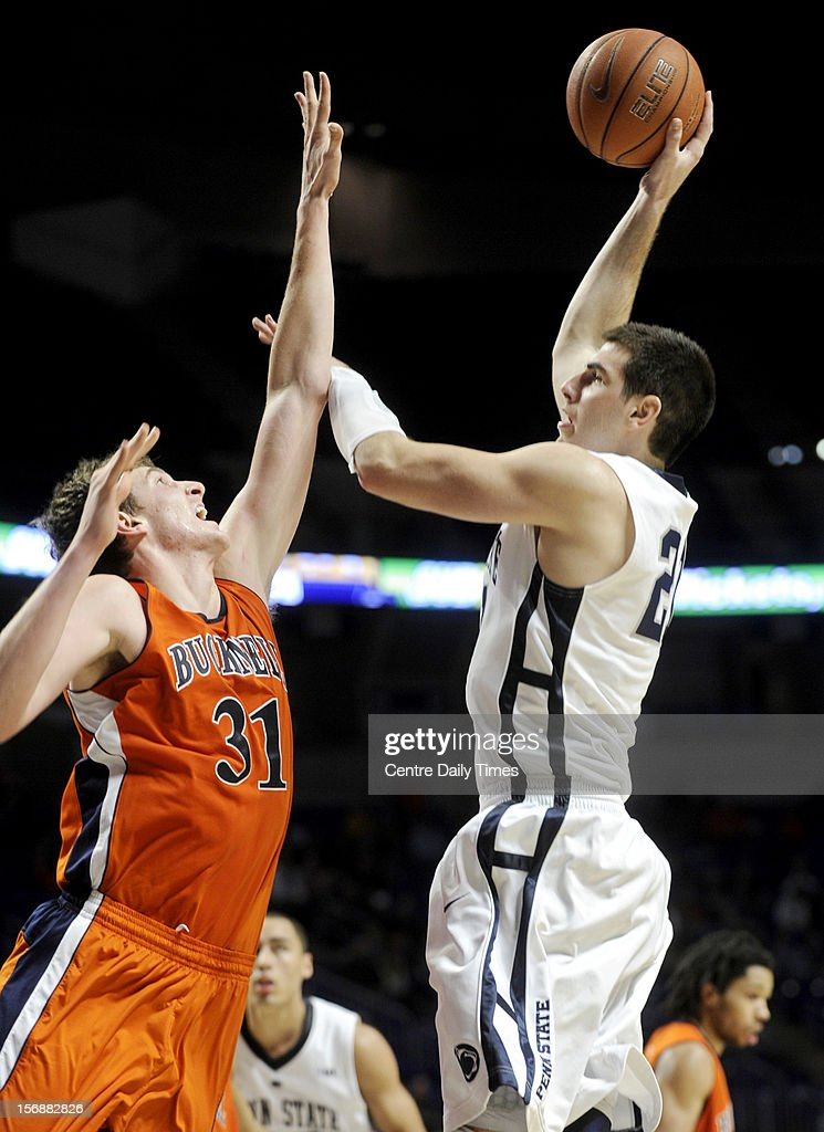 Penn State's Sasa Borovnjak, right, shoots over Bucknell's Mike Muscala on Friday, November 23, 2012, at the Bryce Jordan Centerin University Park, Pennsylvania. Penn State prevailed, 60-57.