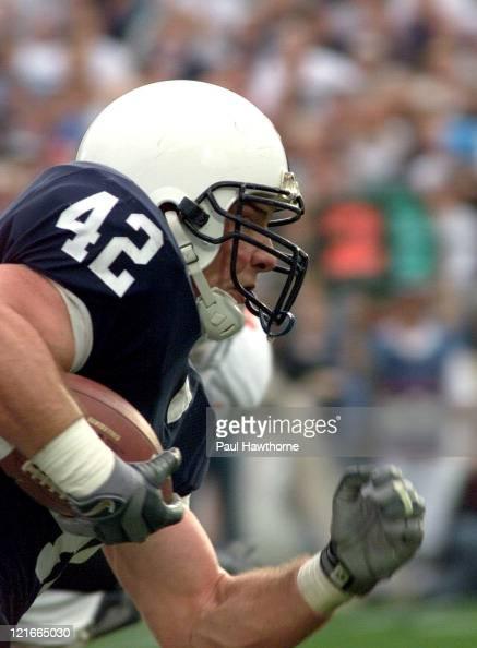 Penn State's Sean McHugh rushes for yardage in the first half against Ohio State at Beaver Stadium University Park Pennsylvaina November 1 2003