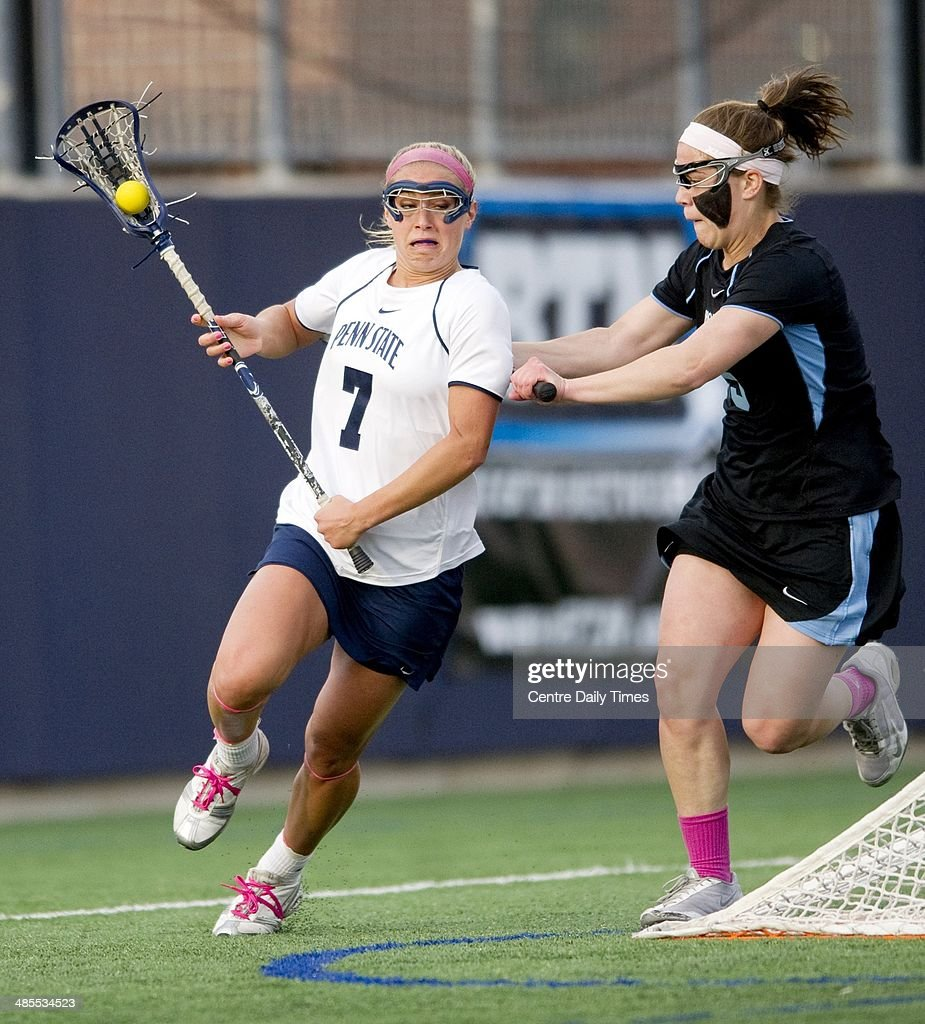Penn State's Tatum Coffey (7) cuts behind the goal with the ball from John Hopkin's defenders during the first half in State College, Pa., Friday, April 18, 2014.