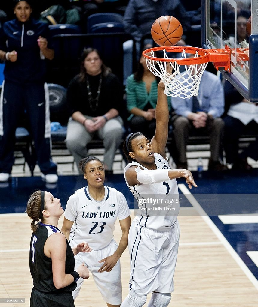 Penn State's Tori Waldner (44) passes to a teammate over Northwestern's Ashley Deary on Thursday, Feb. 20, 2014, at the Bryce Jordan Center in State College, Pa. The Lady Lions won, 82-73.