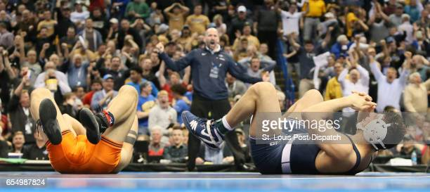 Penn State's Vincenzo Joseph right reacts after pinning Illinois' Isaiah Martinez in their 165pound championship match during the NCAA Division I...