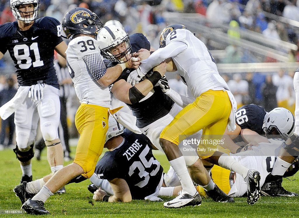 Penn State's Zach Zwinak tries to push through Kent State's Luke Wollet and Malcolm Pannell at Beaver Stadium in State College, Pennsylvania, on Saturday, September 21, 2013.