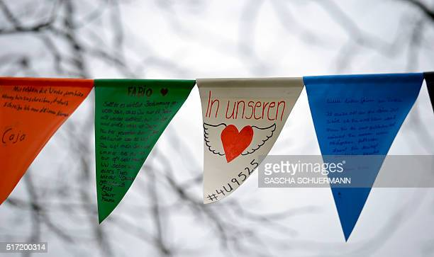 A pennant of a mourning banner fixed in front of the JosephKoenigGymnasium secondary school reads ' In Our Hearts' and the flight number '4U9525' in...