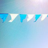 Pennants hanging against blue sky