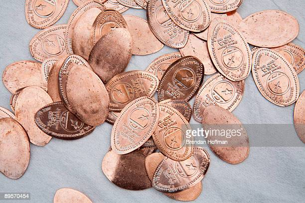 Pennies which have been flattened and imprinted with the Street Soccer USA Cup logo sit on a table at the Street Soccer USA Cup tournament on August...