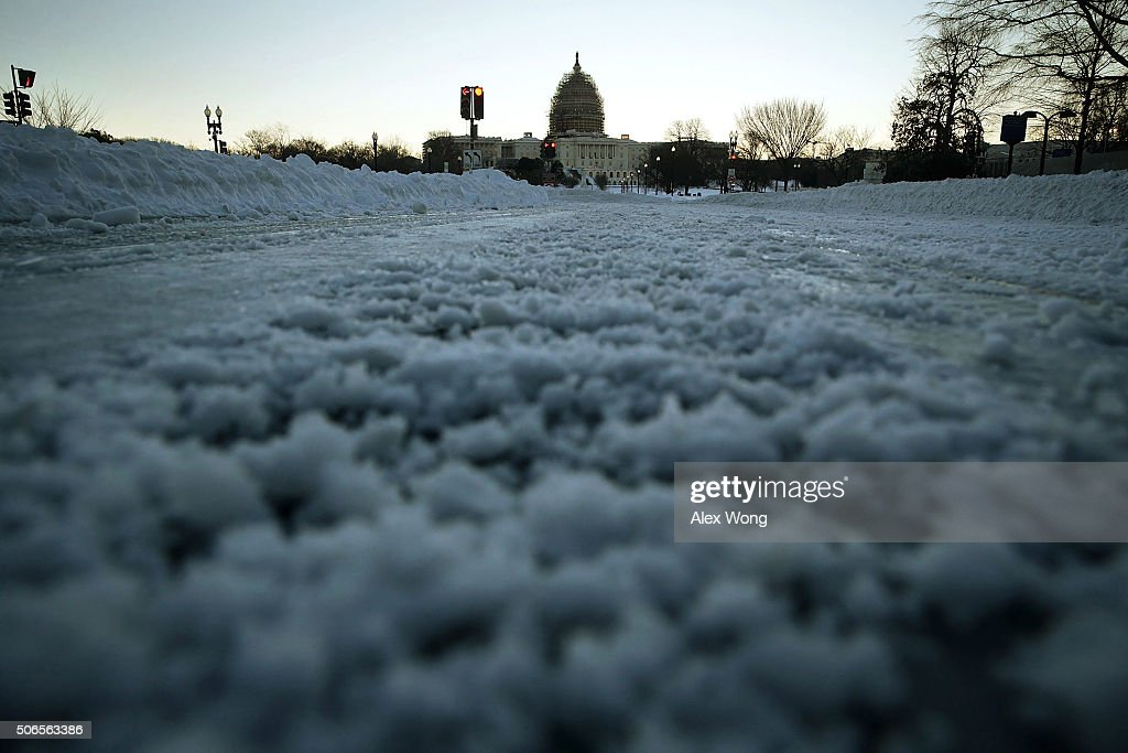 Pennsylvania Avenue in front of the US Capitol is covered with snow on January 24 2016 in Washington DC The blizzard that has brought massive...