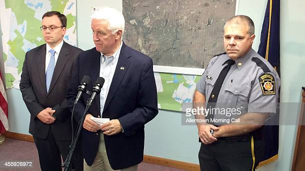 Pennsylvania Governor Tom Corbett center speaks to the media at the Blooming Grove Municipal Township Building in Blooming Grove Pa to comment on the...