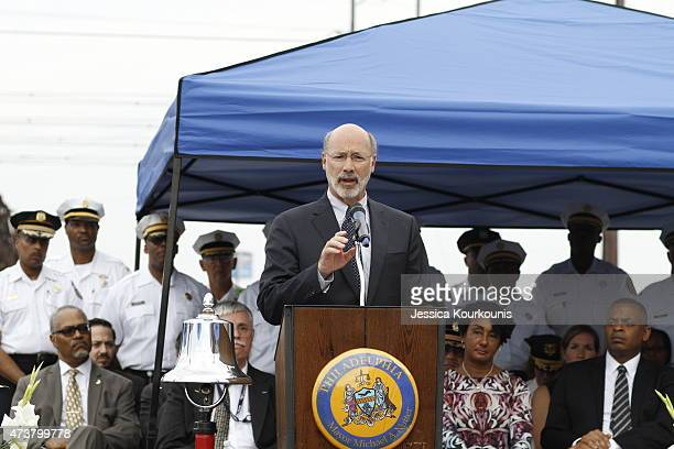 Pennsylvania Governor Tom Wolf speaks at a memorial service on May 17 2015 at the site of the recent Amtrak derailment in Philadelphia Pennsylvania...