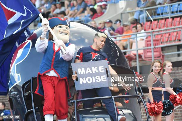 Pennsylvania Quakers cheerleaders and mascot celebrate a touchdown during a college football game between the Penn Quakers and the Ohio Dominican...