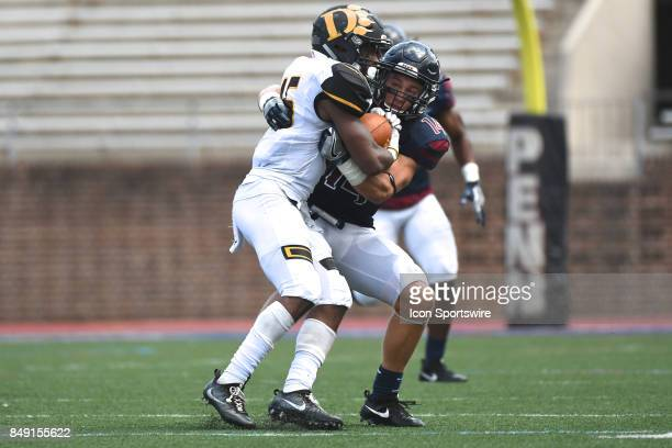 Pennsylvania Quakers defensive back Sam Philippi tackles Ohio Dominican Panthers quarterback Thomas Wibbeler during a college football game between...
