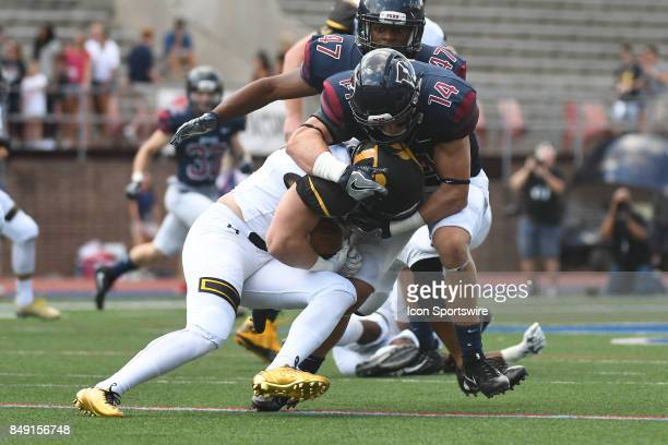 Pennsylvania Quakers defensive back Sam Philippi tackles Ohio Dominican Panthers running back Brandon Schoen for a loss during a college football...