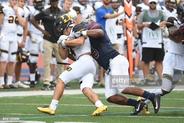 Pennsylvania Quakers defensive end Louis Vecchio tackles Ohio Dominican Panthers wide receiver Casey Williams for a loss during a college football...