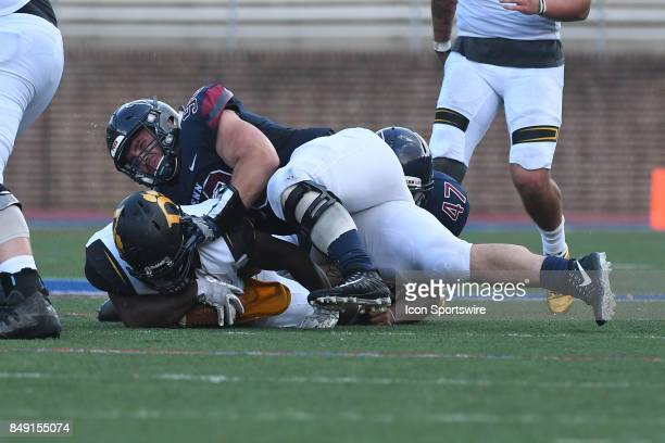 Pennsylvania Quakers defensive lineman Brody Graham tackles Ohio Dominican Panthers runner during a college football game between the Penn Quakers...