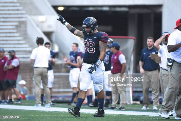 Pennsylvania Quakers defensive lineman David Ryslik celebrates a fumble recovery during a college football game between the Penn Quakers and the Ohio...