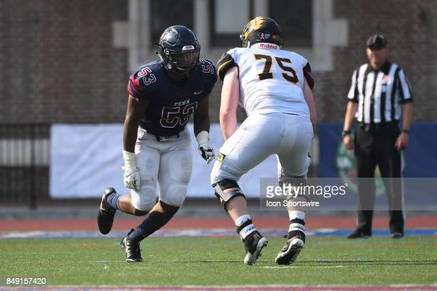 Pennsylvania Quakers defensive lineman Taheeb Sonekan is blocked by Ohio Dominican Panthers offensive lineman Zack Williams during a college football...