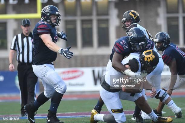 Pennsylvania Quakers defensive lineman Taheeb Sonekan sacks the quarterback during a college football game between the Penn Quakers and the Ohio...