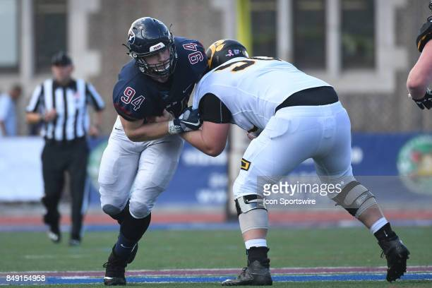 Pennsylvania Quakers defensive lineman Tayler Hendrickson is blocked by Ohio Dominican Panthers offensive lineman Tyler EdwardsFrick during a college...