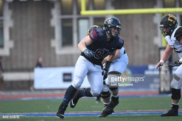 Pennsylvania Quakers defensive lineman Tayler Hendrickson rushes the pocket during a college football game between the Penn Quakers and the Ohio...