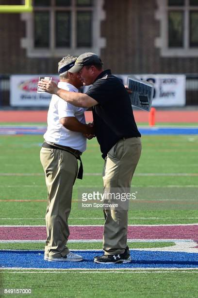 Pennsylvania Quakers head coach Ray Priore and Ohio Dominican Panthers head coach Kelly Cummings shake hands during a college football game between...