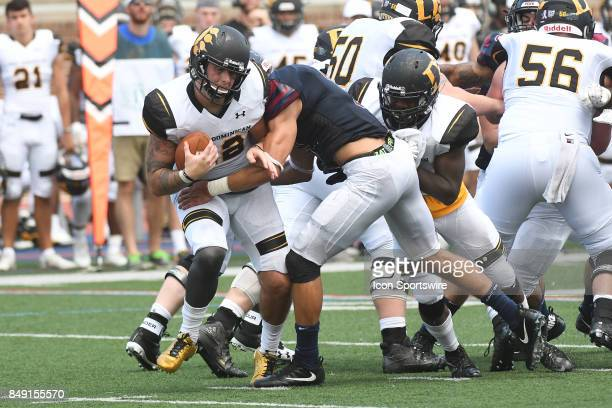 Pennsylvania Quakers linebacker Nico Ament sacks Ohio Dominican Panthers quarterback Grant Russell for a loss during a college football game between...