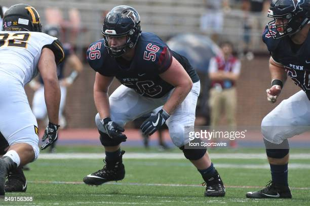 Pennsylvania Quakers offensive lineman Jeff Gibbs sets to block during a college football game between the Penn Quakers and the Ohio Dominican...