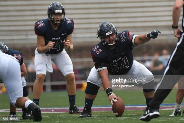 Pennsylvania Quakers offensive lineman Nathan Kirchmier points to the defense during a college football game between the Penn Quakers and the Ohio...