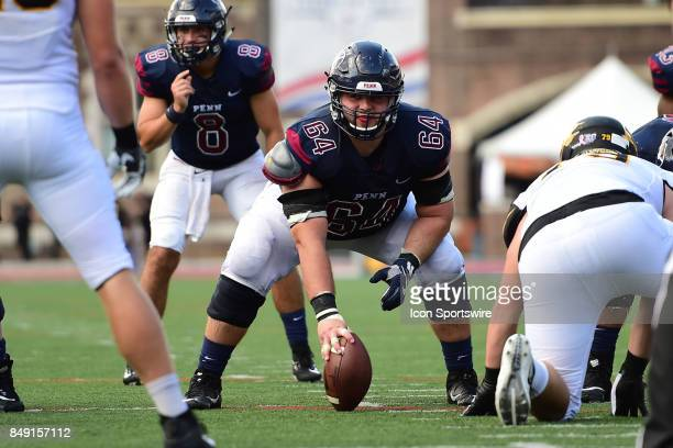 Pennsylvania Quakers offensive lineman Nathan Kirchmier prepares to snap the ball during a college football game between the Penn Quakers and the...