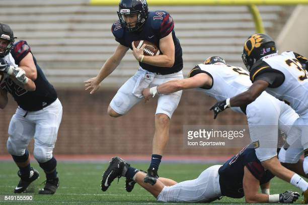 Pennsylvania Quakers quarterback Will FischerColbrie leaps for a first down during a college football game between the Penn Quakers and the Ohio...