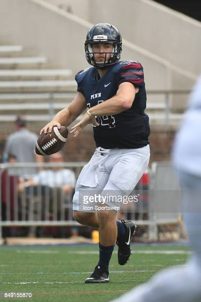 Pennsylvania Quakers quarterback Will FischerColbrie looks to pass during a college football game between the Penn Quakers and the Ohio Dominican...