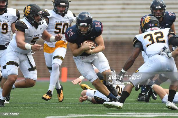 Pennsylvania Quakers quarterback Will FischerColbrie runs the ball during a college football game between the Penn Quakers and the Ohio Dominican...