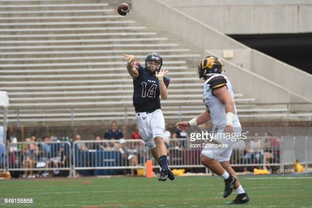 Pennsylvania Quakers quarterback Will FischerColbrie throws a leaping first down pass during a college football game between the Penn Quakers and the...