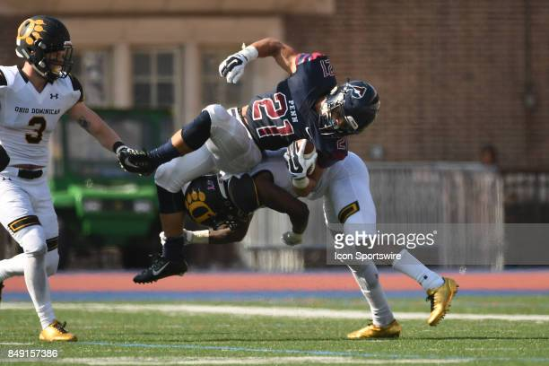 Pennsylvania Quakers running back Abe Willows is upended during a college football game between the Penn Quakers and the Ohio Dominican Panthers on...