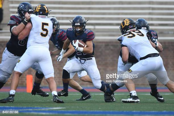 Pennsylvania Quakers running back Abe Willows runs through a hole during a college football game between the Penn Quakers and the Ohio Dominican...