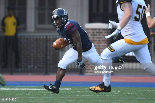 Pennsylvania Quakers running back Isaiah Malcolm runs the ball during a college football game between the Penn Quakers and the Ohio Dominican...