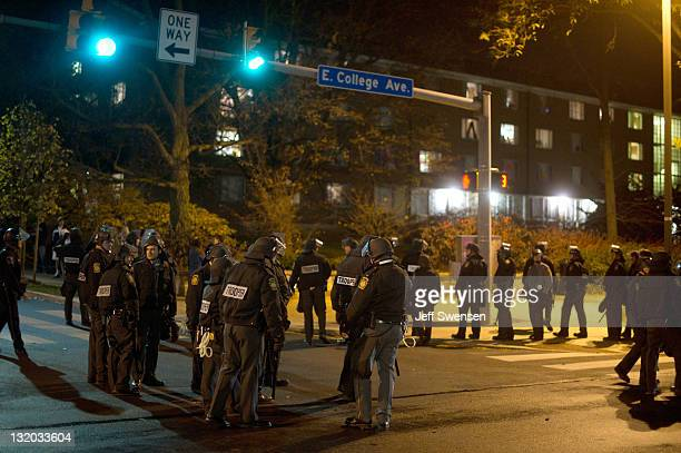 Pennsylvania State Police in riot gear line East College Avenue in the early morning hours on November 10 2011 in State College Pennsylvania Police...