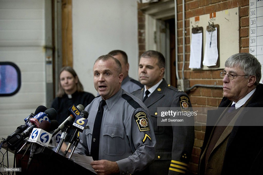 Pennsylvania State Police spokesman Lt Colonel George Bivens (L) describes the scene of a shooting in Blair County on December 21, 2012 in Geeseytown, Hollidaysburg, Pennsylvania. According to reports, a man shot and killed two men and one woman and injured three state troopers before being shot and killed by police along Juniata Valley Road in Frankstown Township.