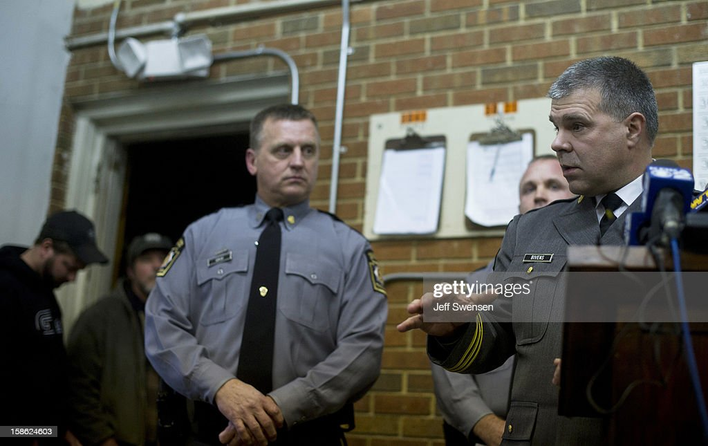 Pennsylvania State Police spokesman Lt Colonel George Bivens (R) describes the scene of a shooting in Blair County on December 21, 2012 in Geeseytown, Hollidaysburg, Pennsylvania. According to reports, a man shot and killed two men and one woman and injured three state troopers before being shot and killed by police along Juniata Valley Road in Frankstown Township.